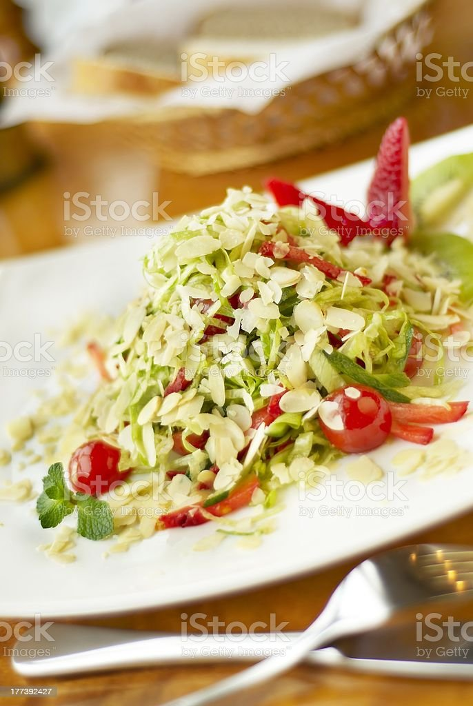 Salad with strawberry, kiwi and almond royalty-free stock photo