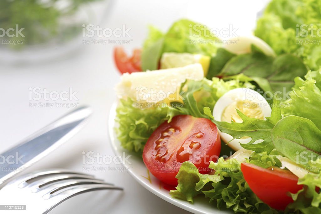 salad with tomatoes and quail egg stock photo