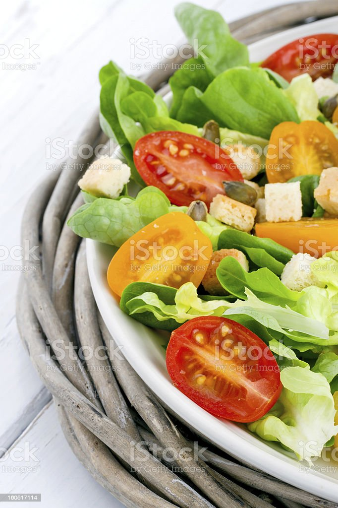 Salad with tomatos and croutons on a plate royalty-free stock photo