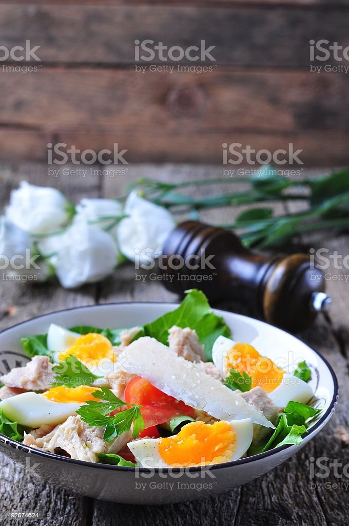 salad with tuna, tomatoes, boiled eggs and parmesan cheese stock photo