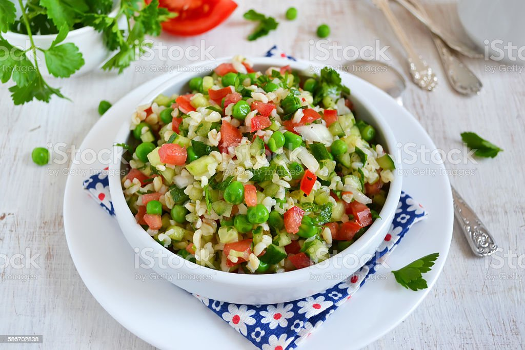 Salad with vegetables, green beans and bulgur stock photo