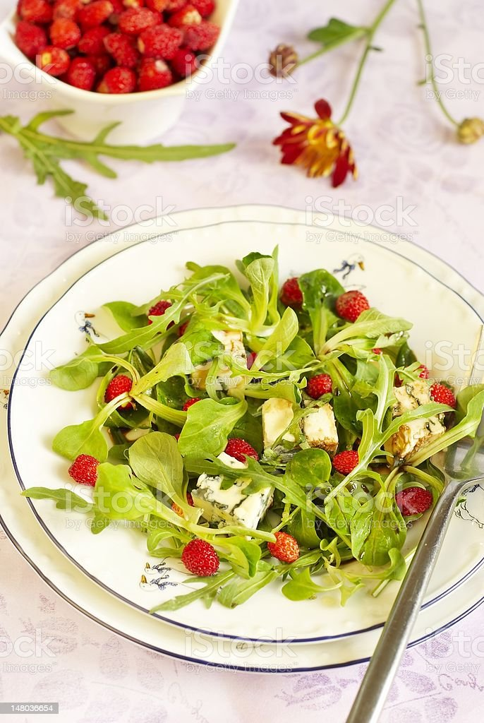Salad with wild strawberry and blue cheese royalty-free stock photo
