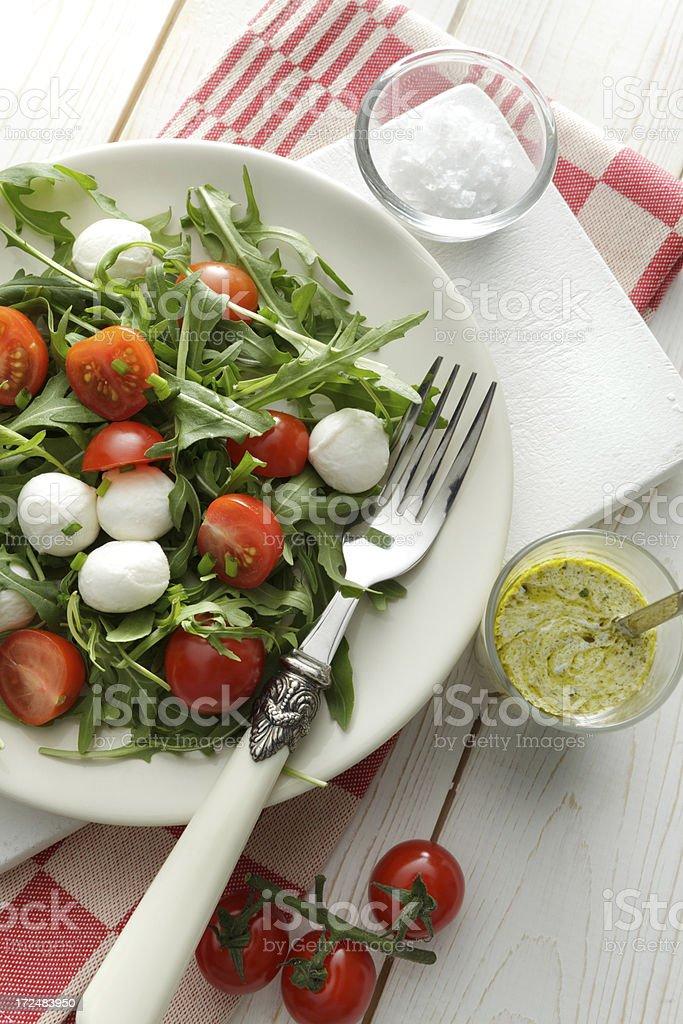 Salads: Arigula Salad with Cherry Tomatos, Mozzarella and Pesto stock photo