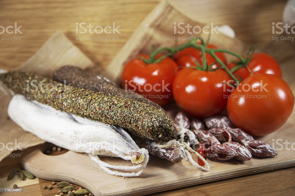 Salami assorted with tomatoes royalty-free stock photo
