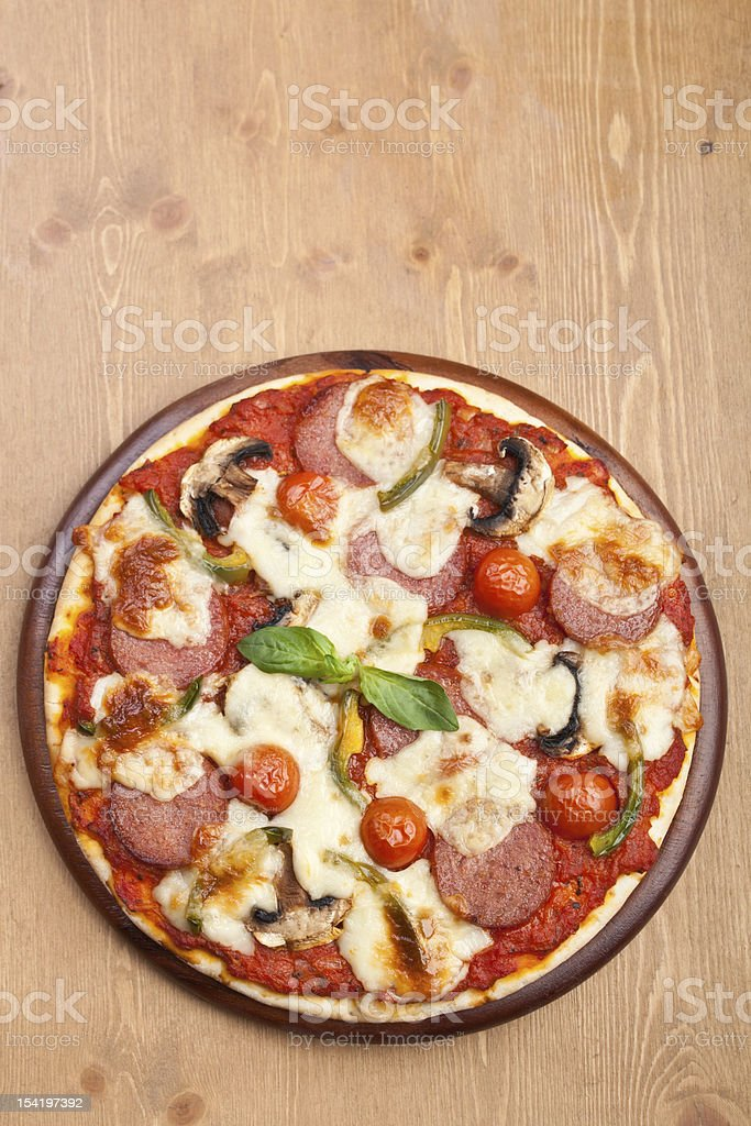salami, mushroom and vegetable pizza royalty-free stock photo