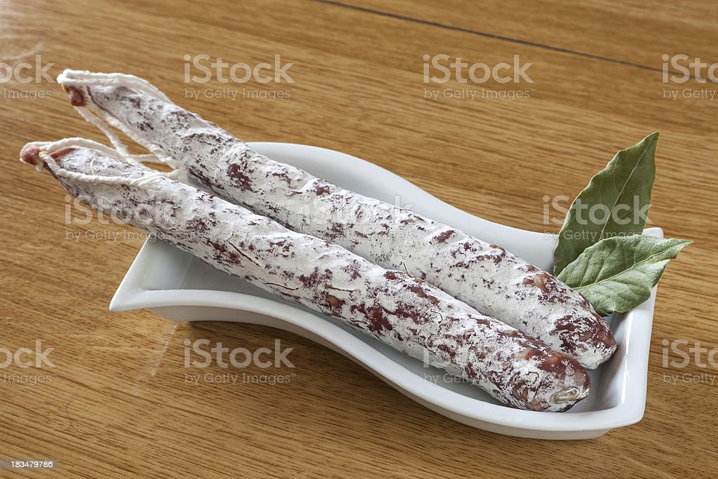 salami on a white plate royalty-free stock photo