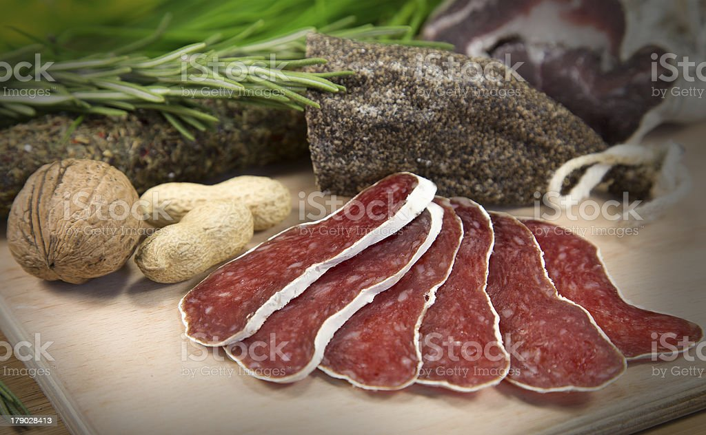 Salami on wood royalty-free stock photo