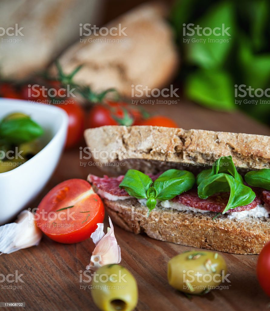 Salami sandwich with cream cheese and basil royalty-free stock photo