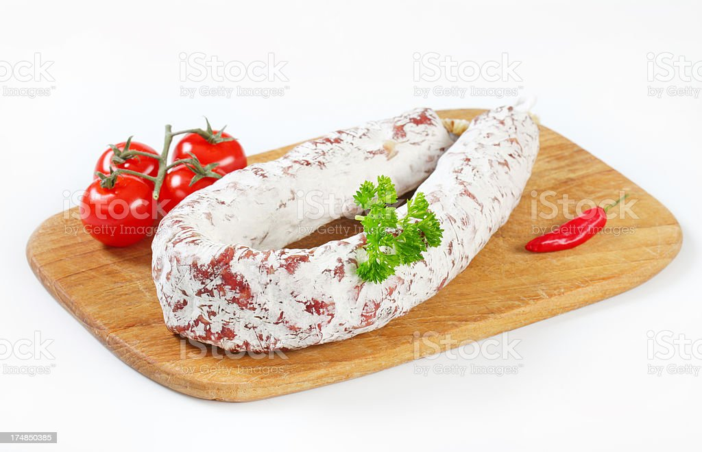 salami sausage and vegetables on cutting board royalty-free stock photo