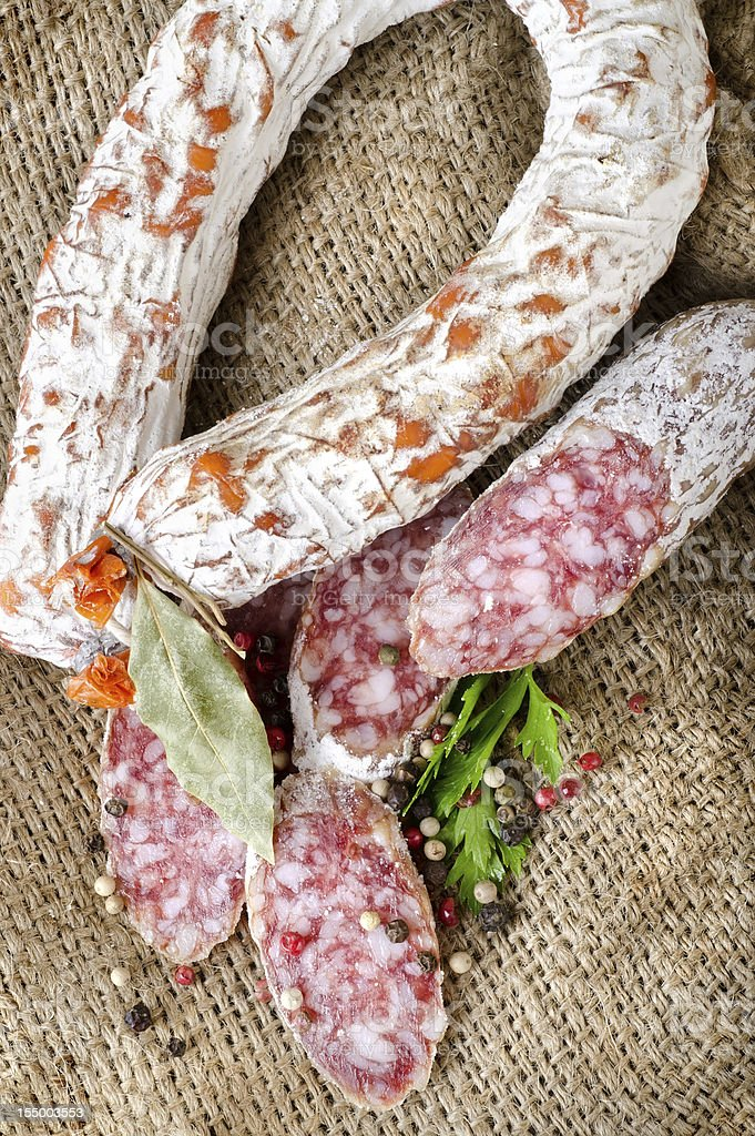 Salami sausage on a canvas royalty-free stock photo