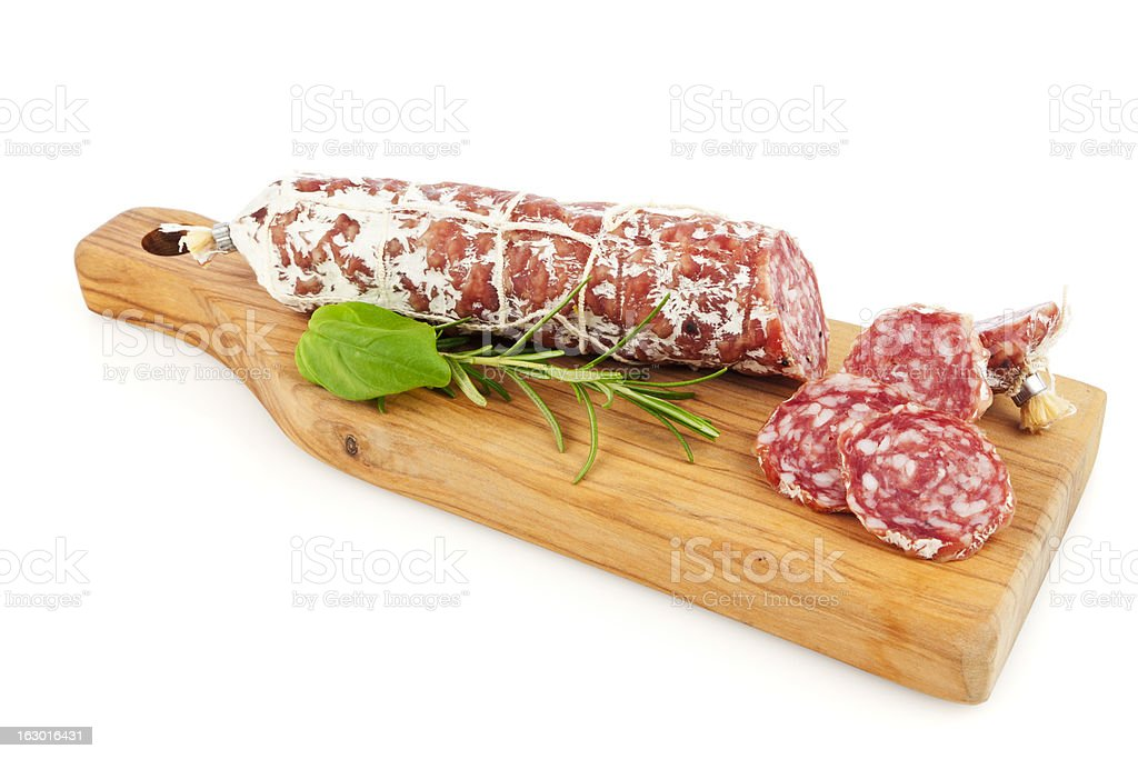 Salami sausage on cutting board isolated royalty-free stock photo