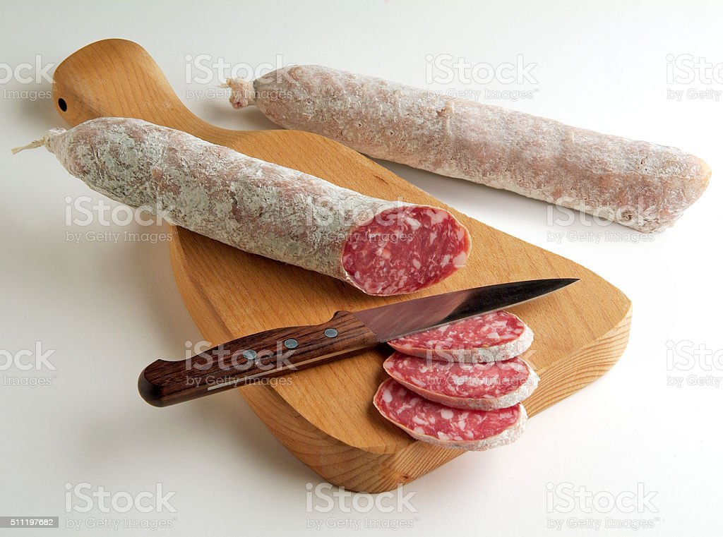 Salami Sliced on Cutting board stock photo