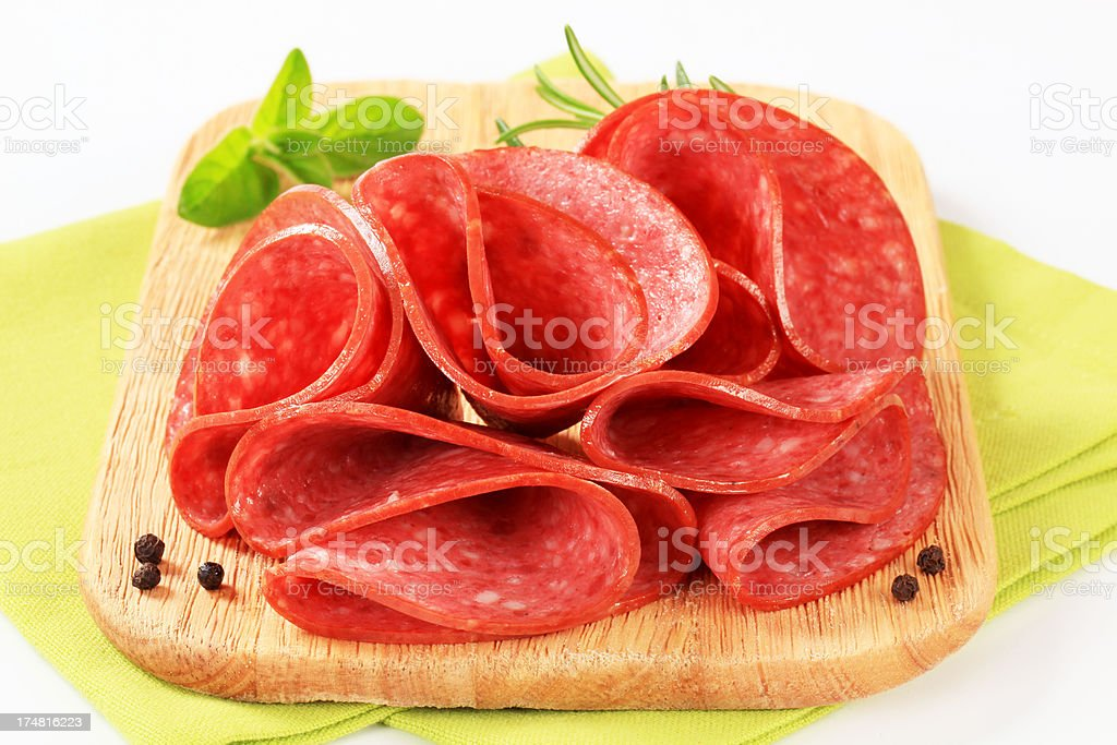 salami slices on a cutting board royalty-free stock photo