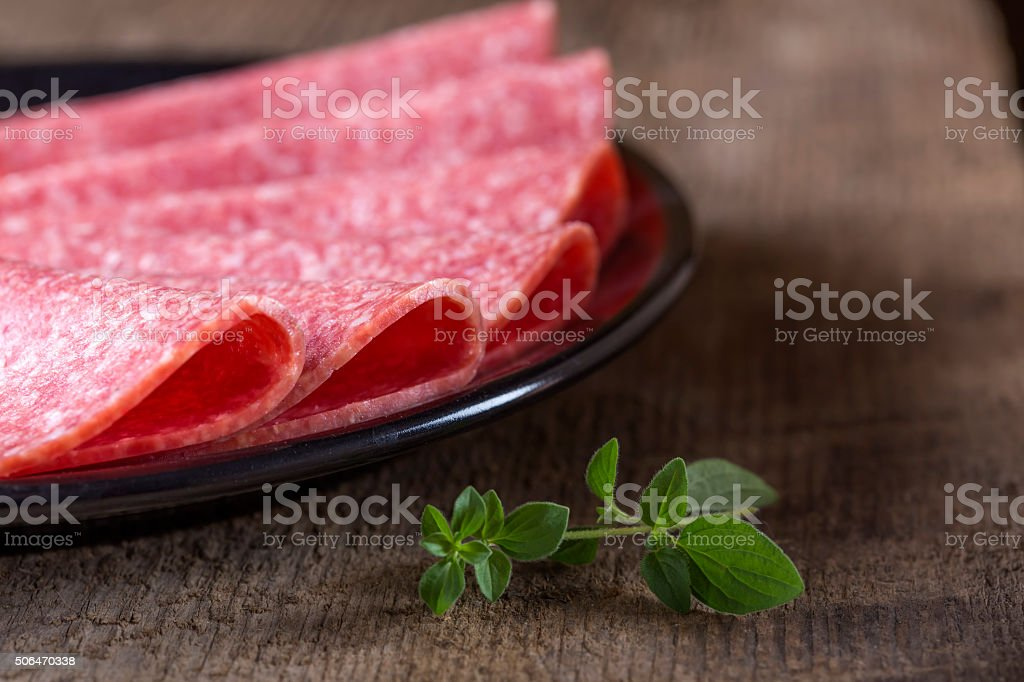 Salami slices on plate stock photo
