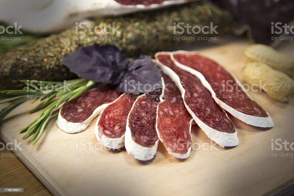 Salami with basil royalty-free stock photo