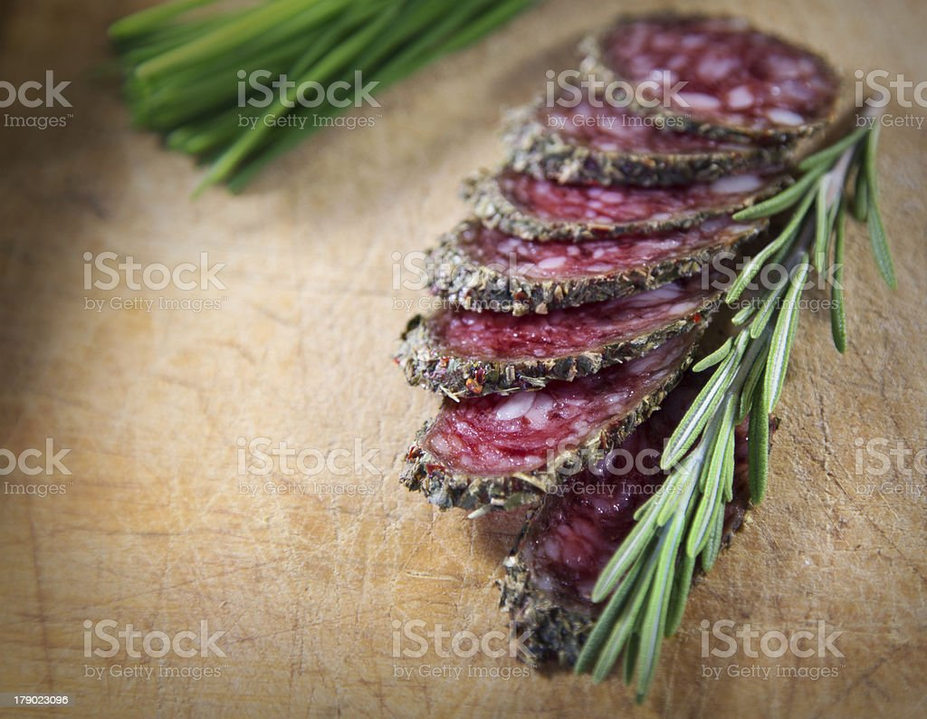 Salami with rosemary royalty-free stock photo