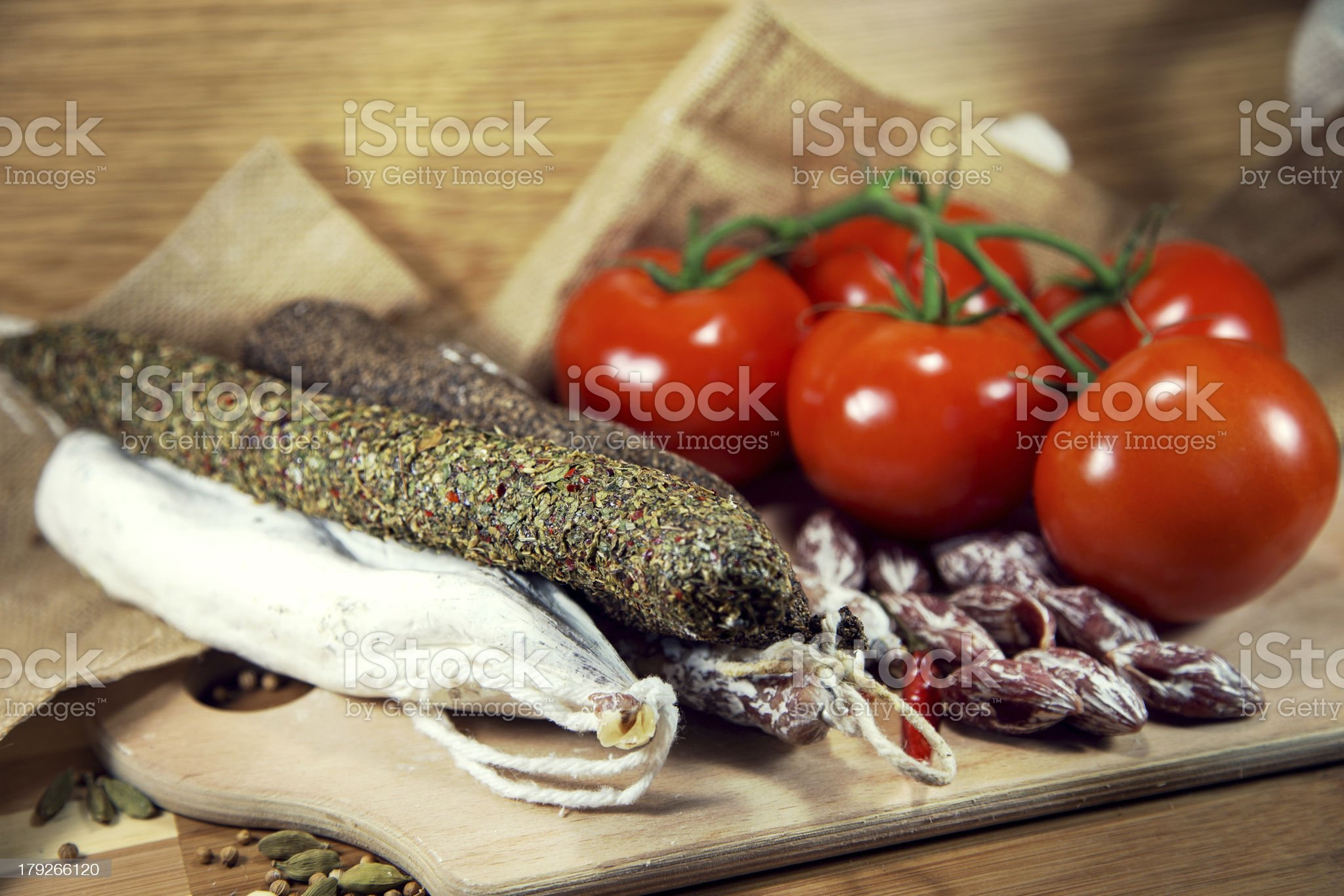 Salami with tomatoes royalty-free stock photo