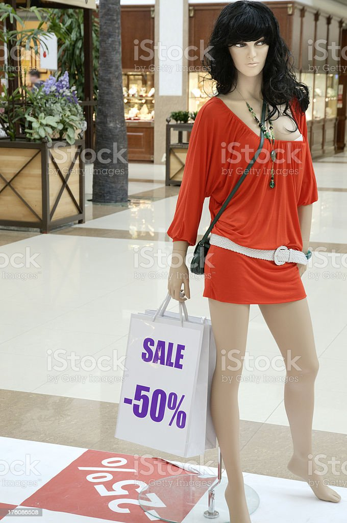 Sale at the shopping mall - mannequuin in red dress royalty-free stock photo