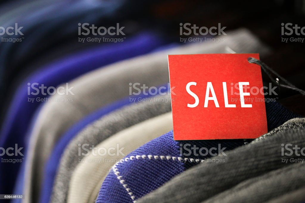 Sale label on sweaters stock photo