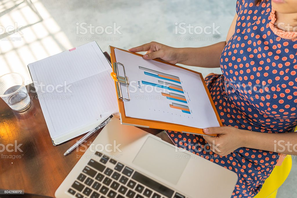 Sale manager working on the sale report with laptop stock photo