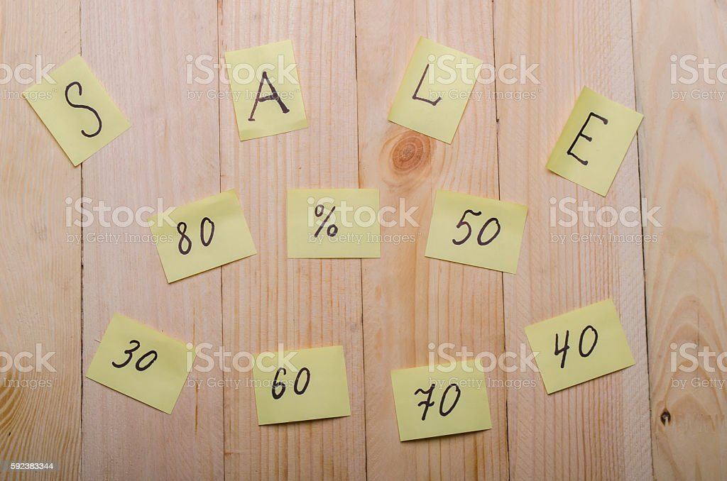 sale on a wooden background stock photo