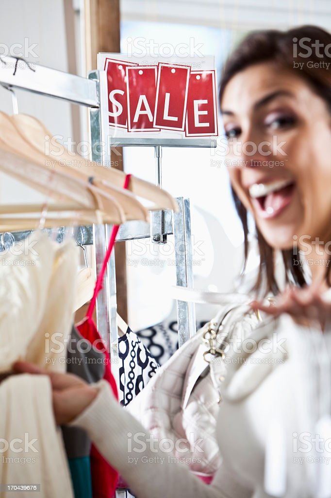 Sale sign in clothing store stock photo