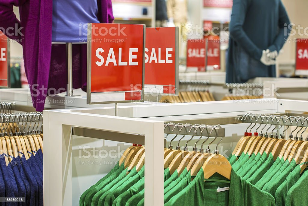 Sale sign in the clothing shop stock photo