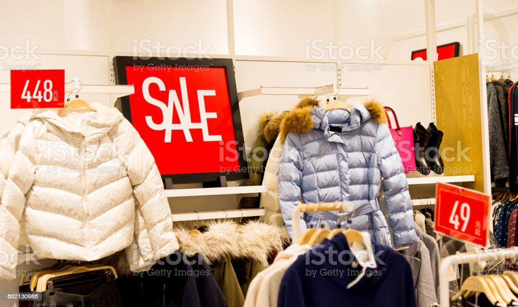 Sale signs in a clothes store stock photo