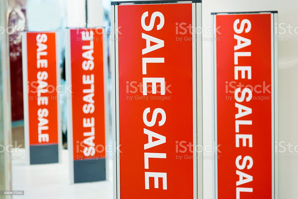 Sale signs in a store stock photo