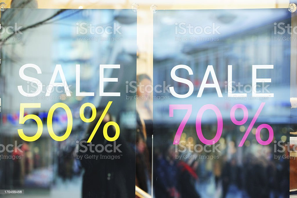 Sale signs in shop window royalty-free stock photo