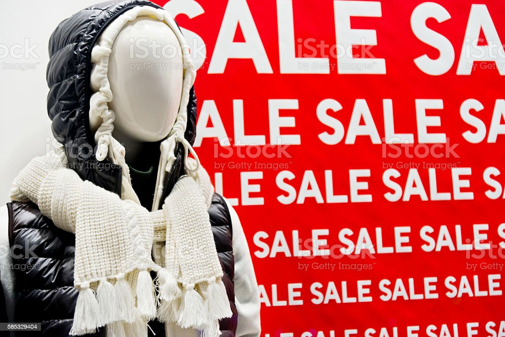 Sale signs on a clothes store stock photo