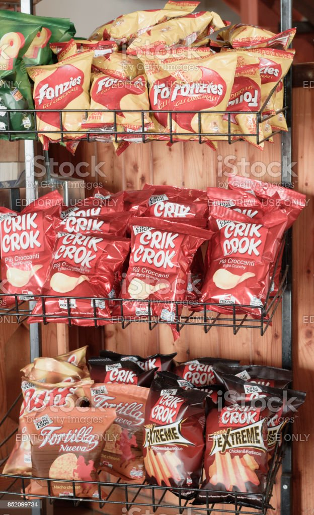 sale stand for junk food with crisps stock photo