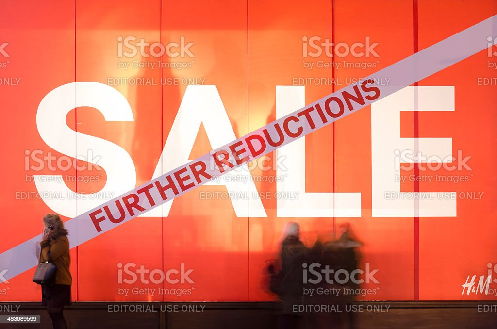 Sale window display on Oxford Street at night, London stock photo