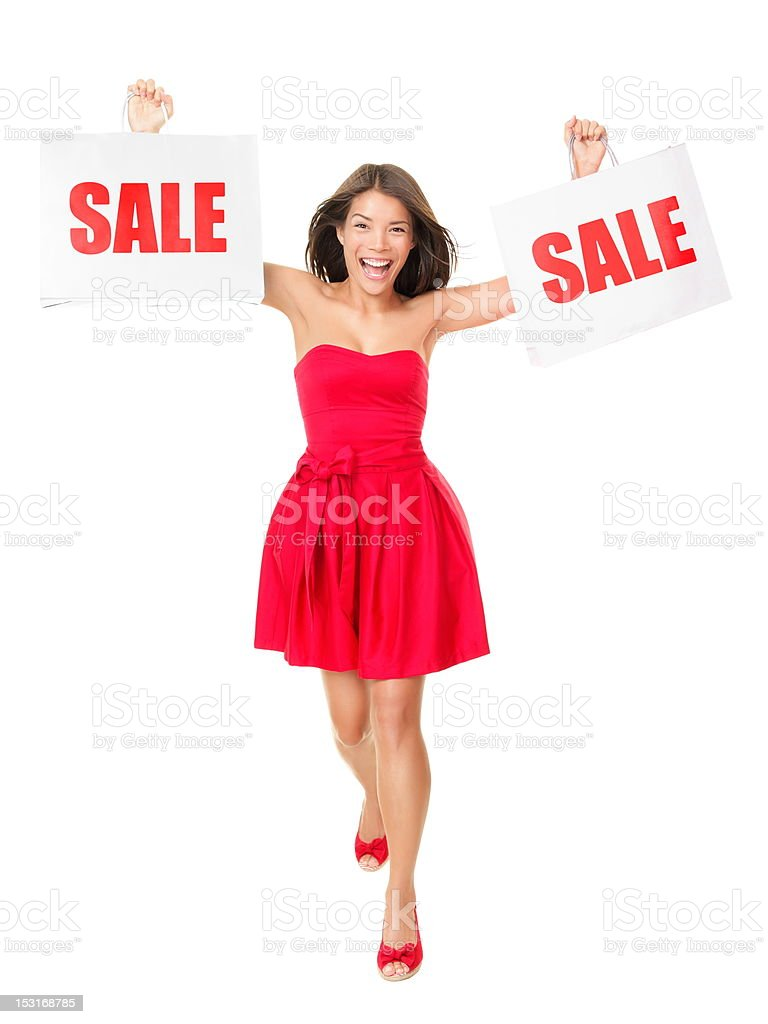 Sale - Woman showing shopping bags royalty-free stock photo