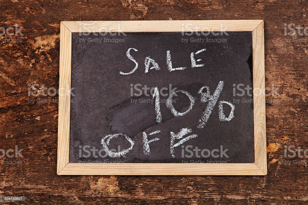 Sale word written on  chalkboard on wooden background stock photo