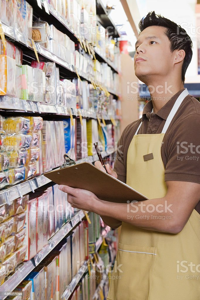 Sales assistant doing a stocktake stock photo