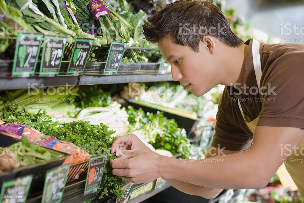 Sales assistant working in a supermarket stock photo