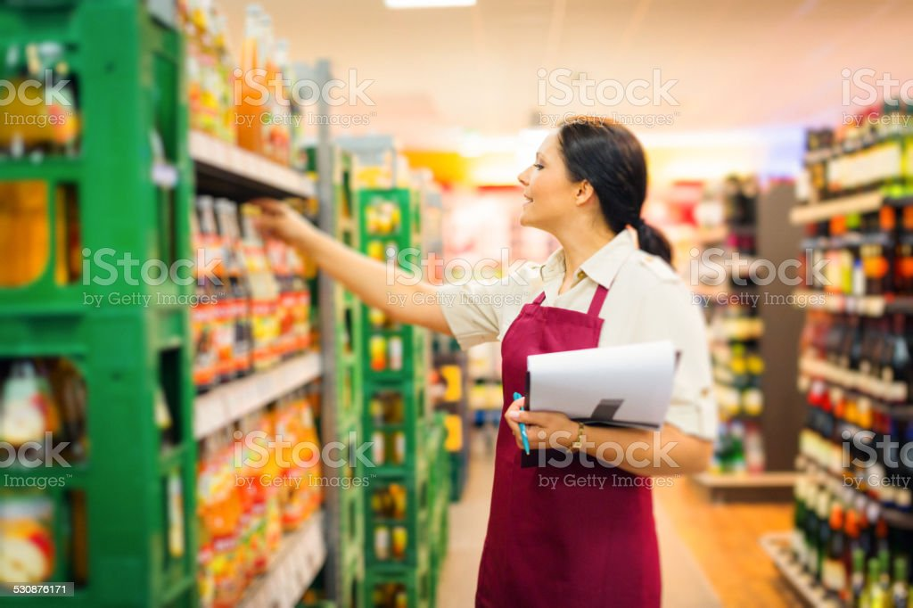 sales clerk at the supermarket stock photo