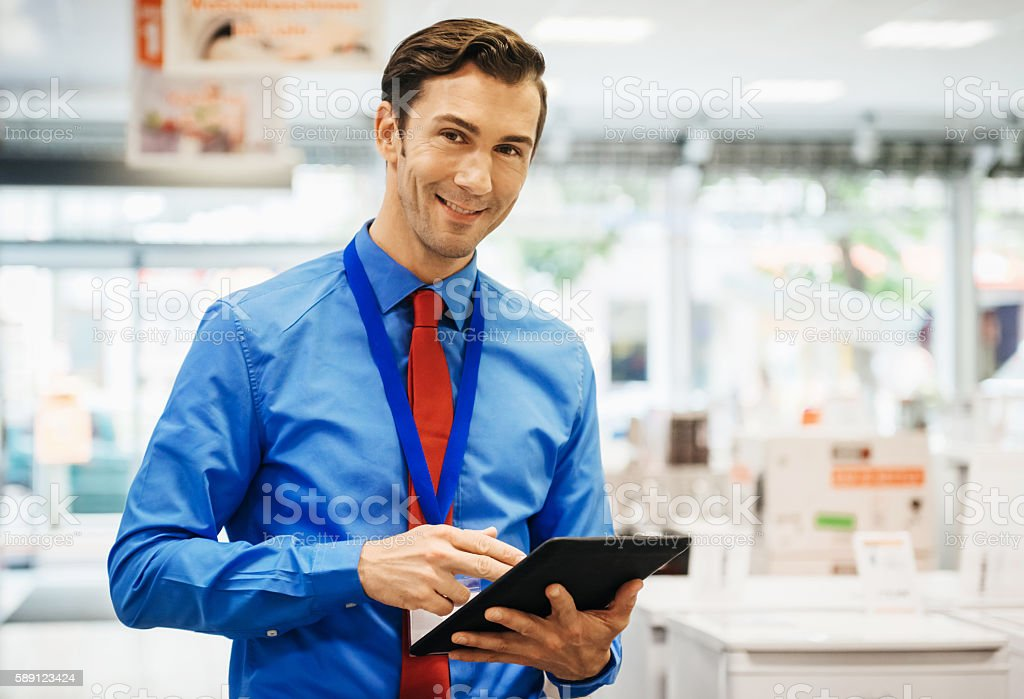 Sales clerk doing online order with tablet pc stock photo