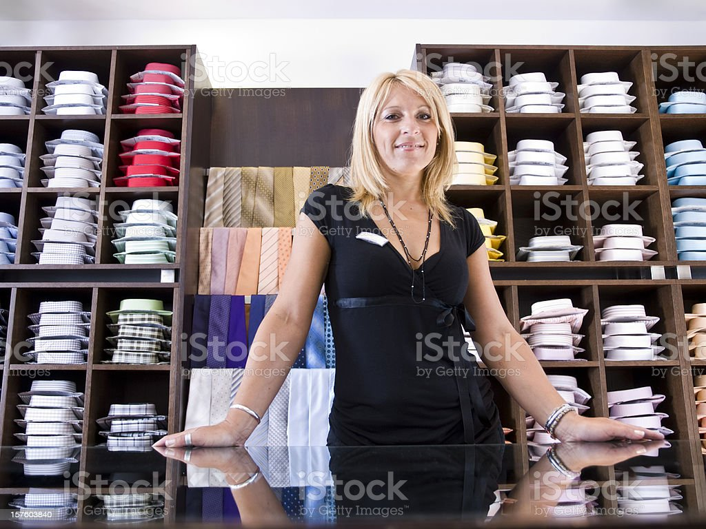 Sales Clerk In Clothing Store royalty-free stock photo
