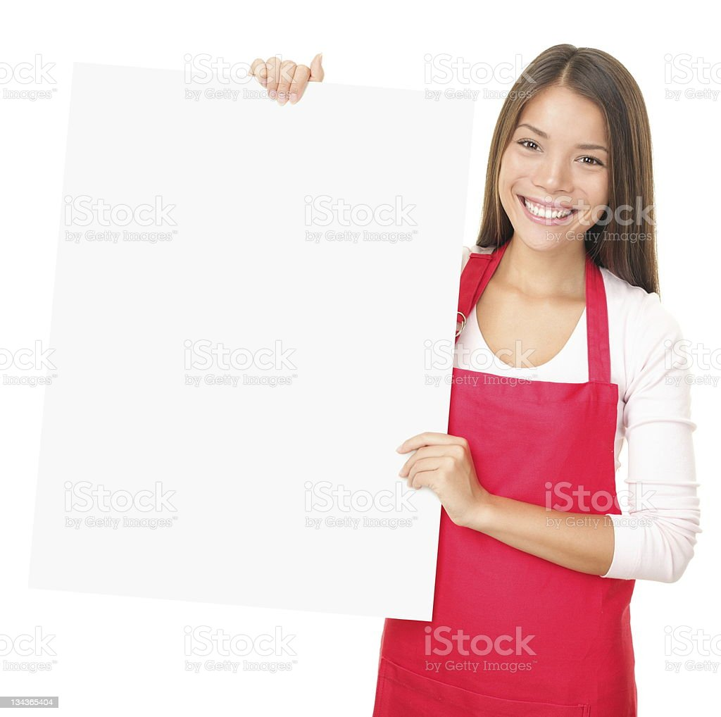 Sales clerk showing blank sign royalty-free stock photo