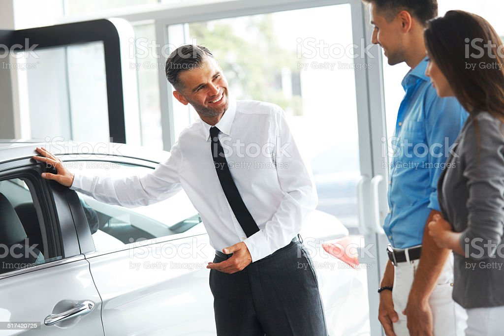 Sales Consultant Showing  New Car to  Potential Buyer stock photo