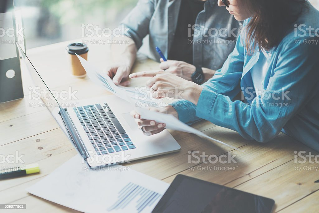 Sales Department Work Process.Photo traders reading market report modern stock photo