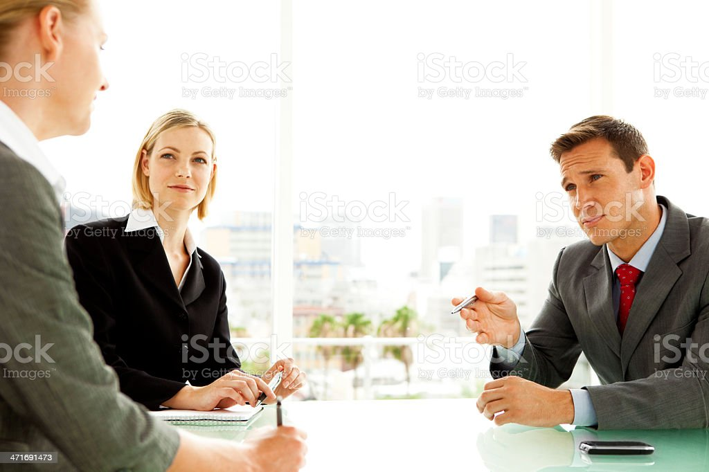 Sales executive trying to persuade at a business meeting royalty-free stock photo