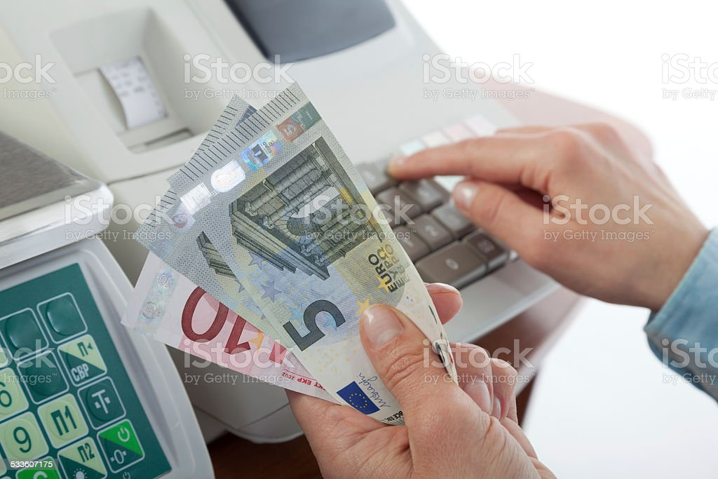 Sales man holding cash in payment for purchases stock photo