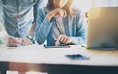 Sales Managers Working Modern Loft.Woman Showing Market Report Digital