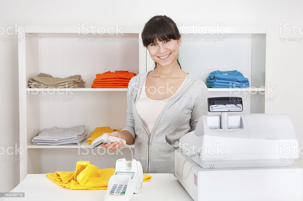 Sales person in the shop royalty-free stock photo