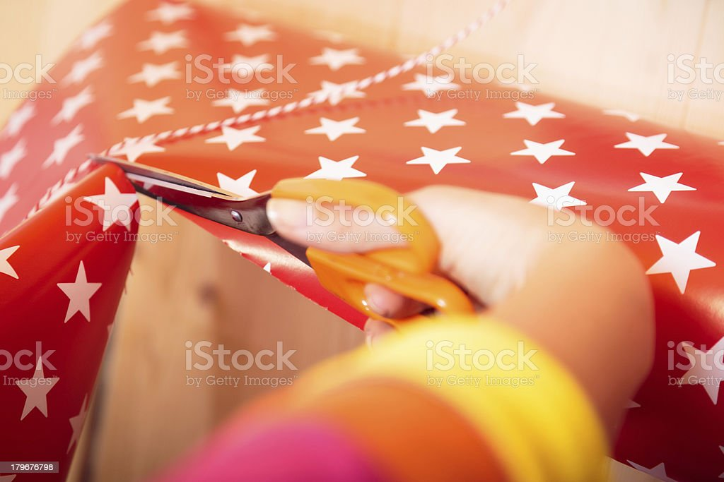 sales person wrapping gift royalty-free stock photo