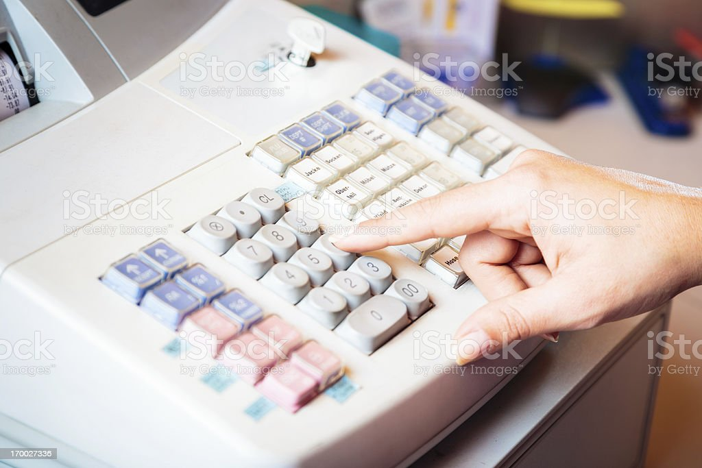 sales person's hand on cash register royalty-free stock photo