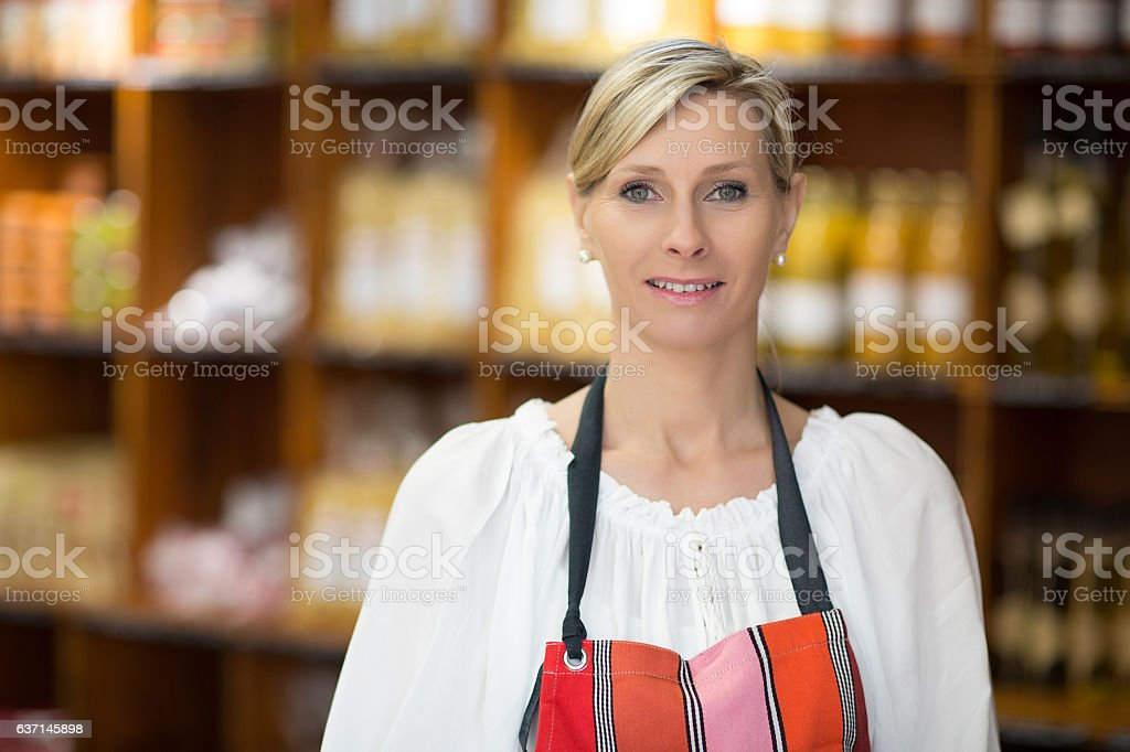 sales woman in grossery store stock photo